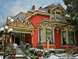 holiday decorated victorian house with snow stock photo picture
