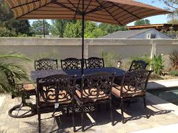 Outdoor Patio Sets With Umbrella Flamingo Outdoor Patio 9pc Dining Set With 44 X 84 Rectangle