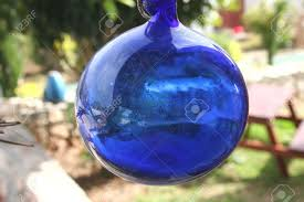 Garden Sphere Balls A Decorative Blue Glass Ball Hanging In The Garden On A Sunny