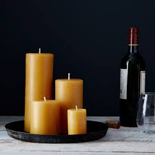 round beeswax pillar candles on food52