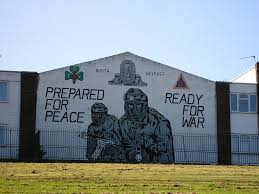 unfinished artefacts the case of northern irish murals continent uvf mural displaying paramilitary emblems masked and armed gunmen and a statement concerning the peace process painted in 2004