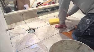 bathroom tiling a bathroom floor around a toilet border tiles