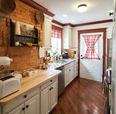 red brick backsplash kitchen farmhouse with ceiling light red trim
