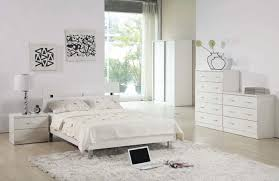 bedroom furnished with white furniture