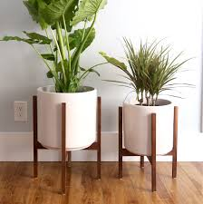 how to build a midcentury inspired plant stand that looks like it