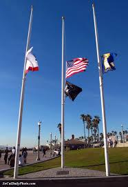 Beach Flag Pole Huntington Beach Flags At Half Staff In Honor Of The Tucson