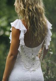 striking low back lace wedding dress with frilly by graceloveslace