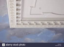 plasterwork and painting of blue sky and clouds on the ceiling in