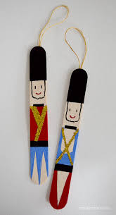 popsicle stick nutcrackers craft ornament and christmas tree