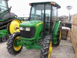 john deere 5055e with 553 loader on right u0026 6140d equipped h310