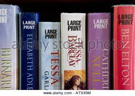 large print books for elderly reading large print library book through magnifying loupe stock