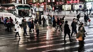 Tokyo Japan Circa November 2016 Crowds Of People Walking In Tokyo by Tokyo Japan Circa November 2016 Crowd Of People Walking In