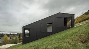 a sight to behold a stable house on a steep slope this group of