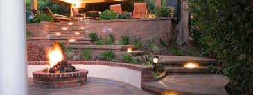 how landscape lighting around a patio walkway or driveway will