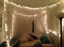 twinkle lights in canopy bed bedroom pinterest canopy