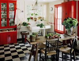 country kitchen with bold red cabinets interiors by color