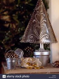 close up of hand made punched tin christmas tree in silver painted