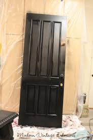 remodelaholic painting a wooden exterior door black