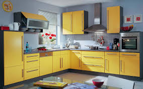 Yellow Kitchens With White Cabinets - yellow cabinets and drawers gray painted wall with ceramic tile