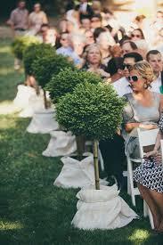 Topiaries Wedding - wedding ceremony aisle arrangements potted plants brides