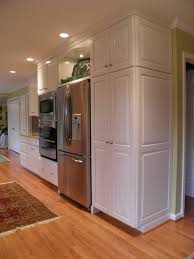 how to build a cabinet around a refrigerator get the look of a built in fridge for less