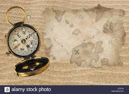 World Treasure Map by Treasure Map And Compass On Sand Stock Photo Royalty Free Image