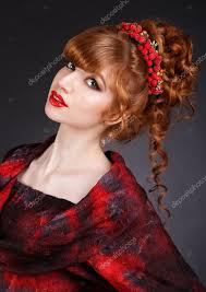 beautiful redhead with long curly hair and a red dress