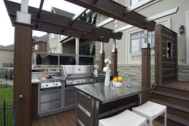 this outdoor kitchen includes a stainless steel island bar from