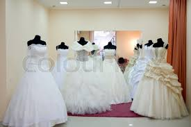 shop wedding dresses shop window with wedding dresses on mannequins stock photo