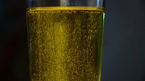 sodium in light beer bubbles in a glass of light beer super slow mo stock footage video