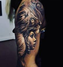 male upper arms black and white lion lady tattoo tattoos