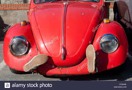 volkswagen car beetle old front view of classic old red painted volkswagen beetle car with