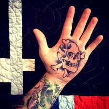 awesome danger skull on palm by shawn barber