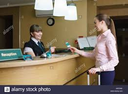 hotel reception administrator and guest communicate with each