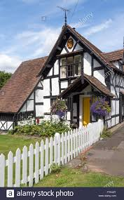english tudor cottage white garden fence and tudor house ombersley worcestershire