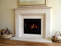 interior white concrete fireplace mantels with frame art and