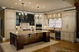 big kitchen island big kitchen island which is placed below chandeliers inside