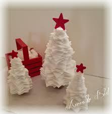 snowy stacked felt christmas trees across the boulevard