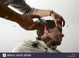 germany hair cuts young man getting his hair cut germany europe stock photo