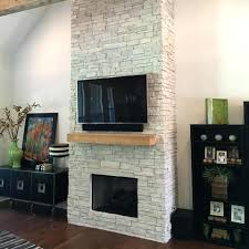 stone fireplace centurion designs outdoor with tv mounted stone