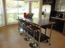 versatile wooden island with stainless steel countertop brown