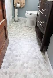 vinyl flooring bathroom ideas she rolls it out cuts it out and 90 minutes later she has this