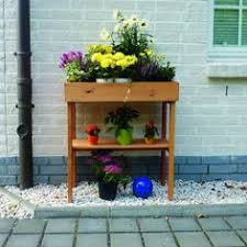 Balcony Planter Box by Wooden Garden Bench With Planters In Cream By Fallen Fruits