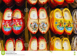 many dutch traditional wooden shoes or clogs for sale in souvenir