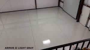 garage epoxy flooring epoxy clear coat on a black epoxy floor