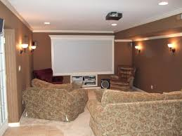 attractive basement with wall sconces and recessed lights best
