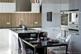 contemporary european kitchen cabinets with an island hood and a