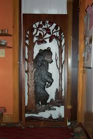 frosted glass front doors carved bear insert would be pretty if it was on a door with