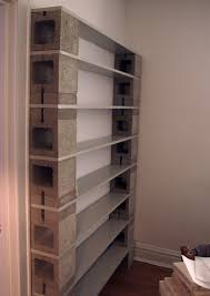 concrete block house tall narrow grey concrete block open shelves having 8 gray wooden