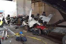 dump truck u0027s cab gets pinned under semi after rear ending it